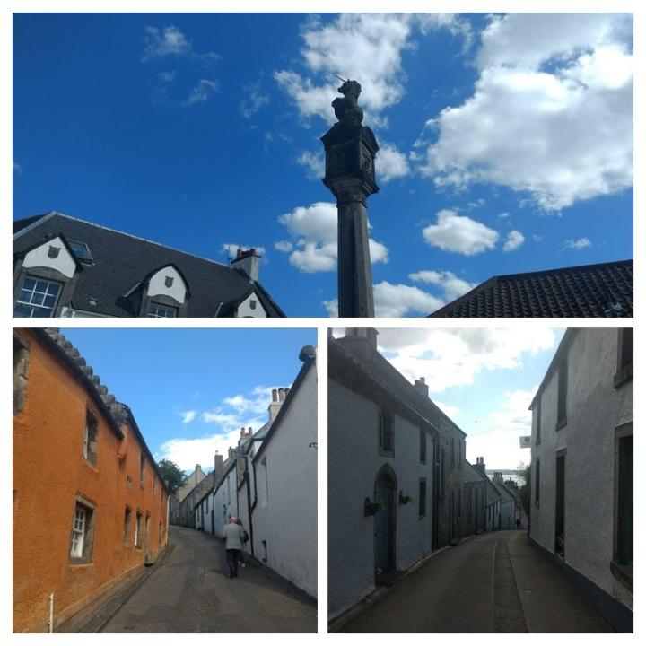Mercat Cross com o unicórnio, animal-símbolo da Escócia; e as construções típicas da vila